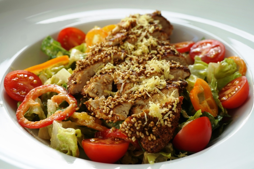 Sesame chicken with roma salad